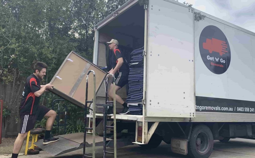 Furniture Removalists Melbourne Get 'n' Go Removals moving furniture into truck